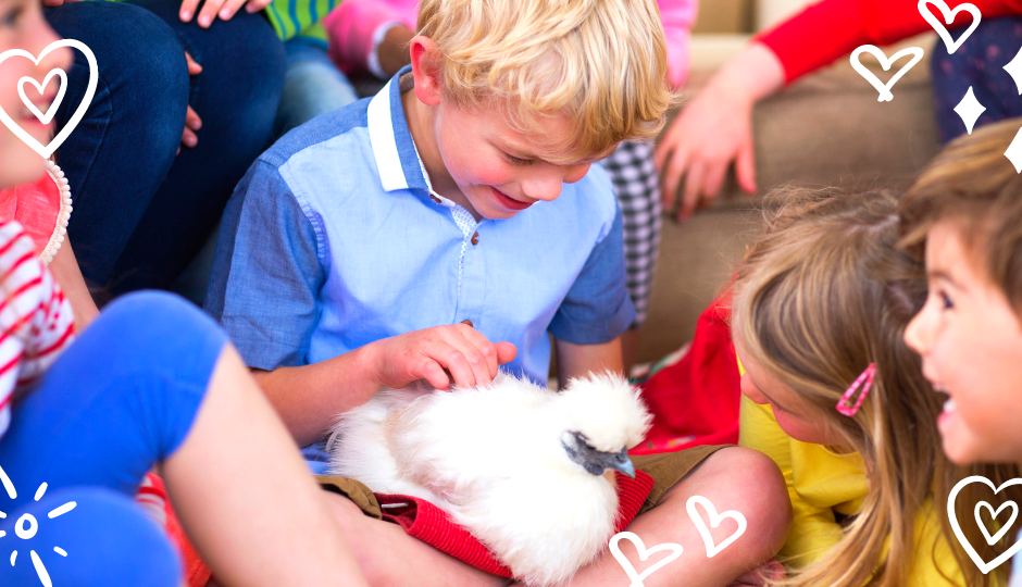 children playing with a white silkie chicken