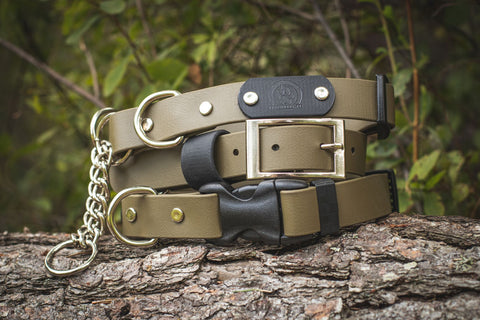 Olive drab Backwoods Dog waterproof BioThane vegan leather dog collars, martingale, buckle and quick release collar styles stacked on a log