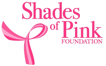 The Shades of Pink Foundation logo. It is a pink breast cancer ribbon in the lower left corner, and a pink font.