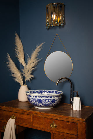 blue and white wash basin on stand by the way we live London