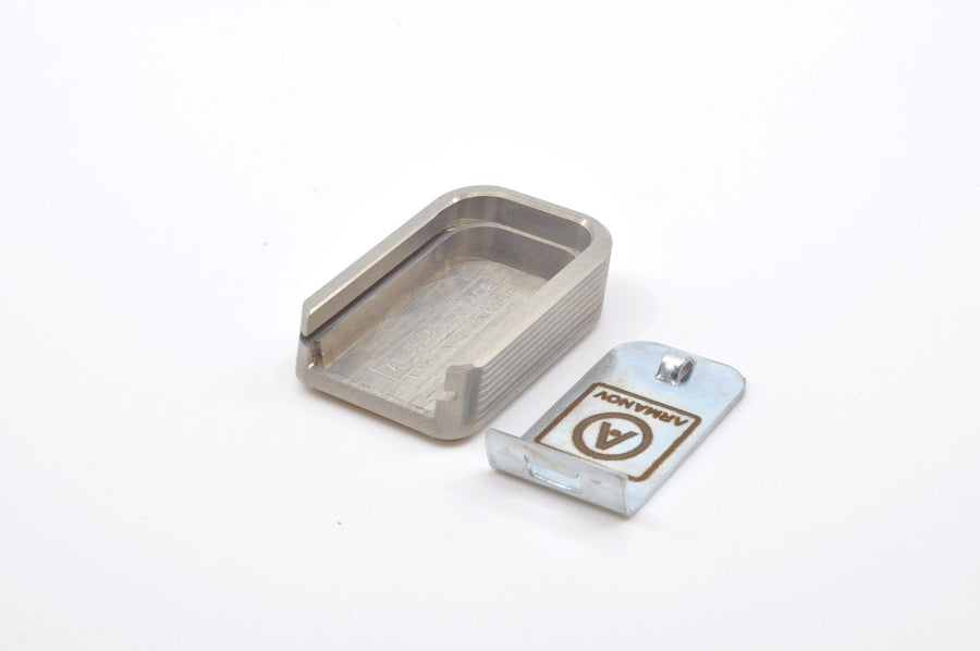 Silver magazine base pad with locking plate