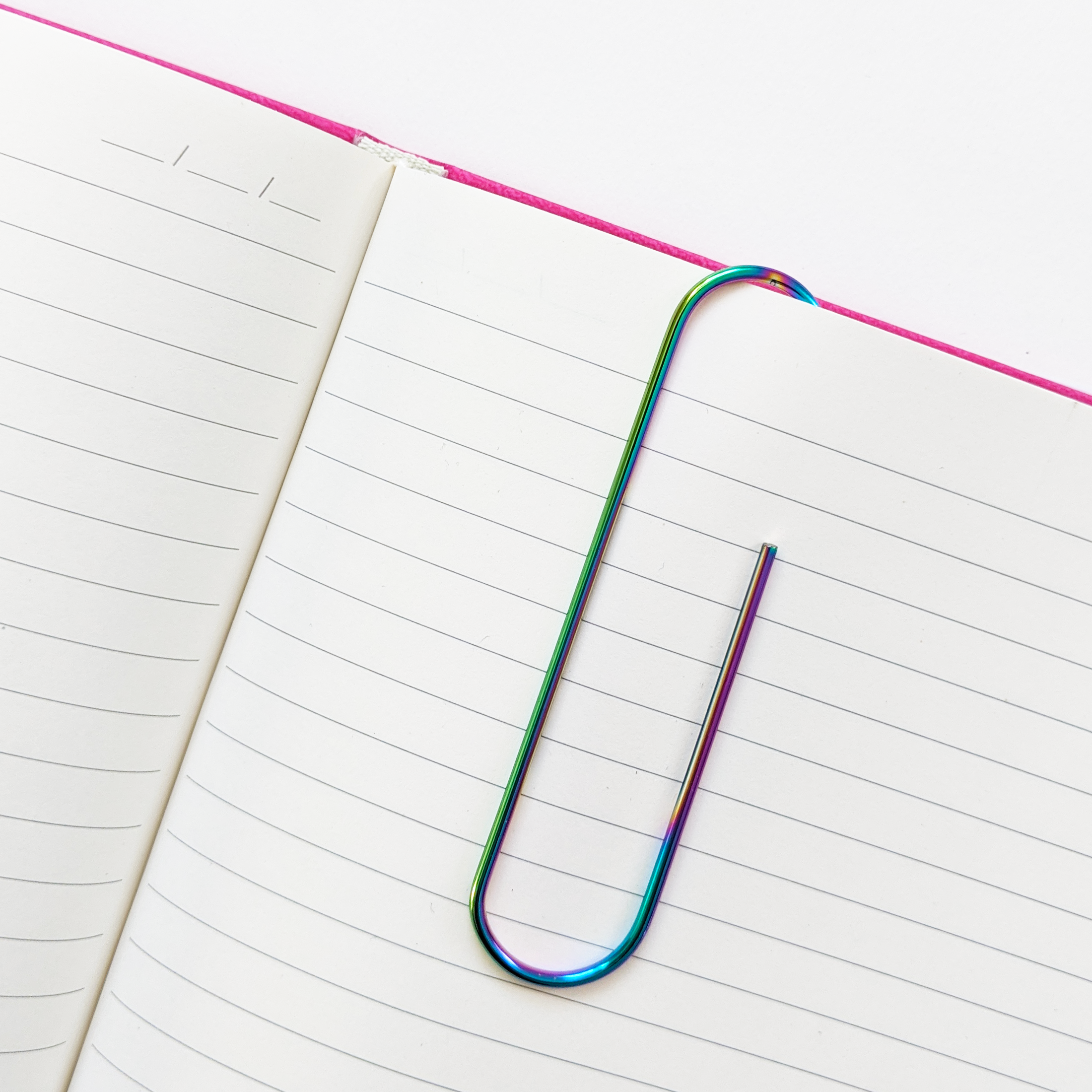 Rainbow Iridescent Large Paper Clip in Notebook