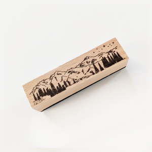 Chunky wood block stamp with mountain design