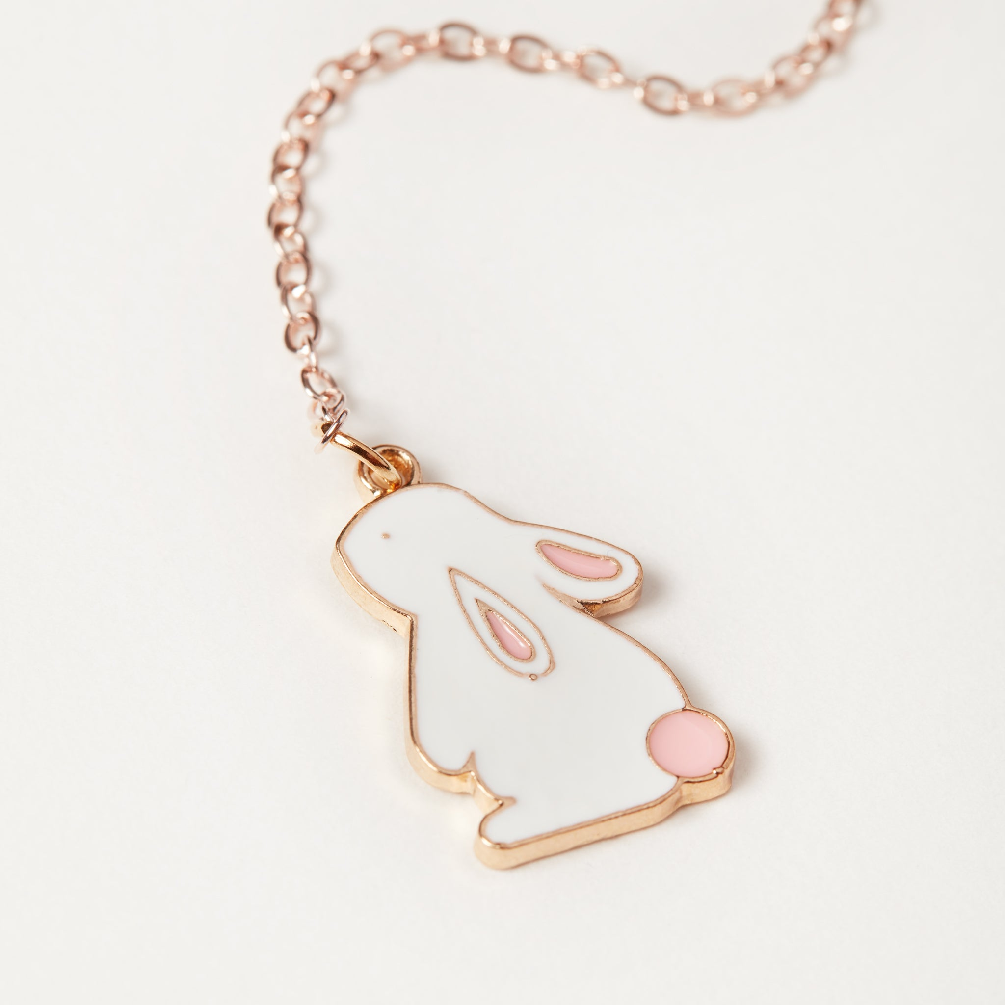 Enamel metal bunny charm on a chain close up