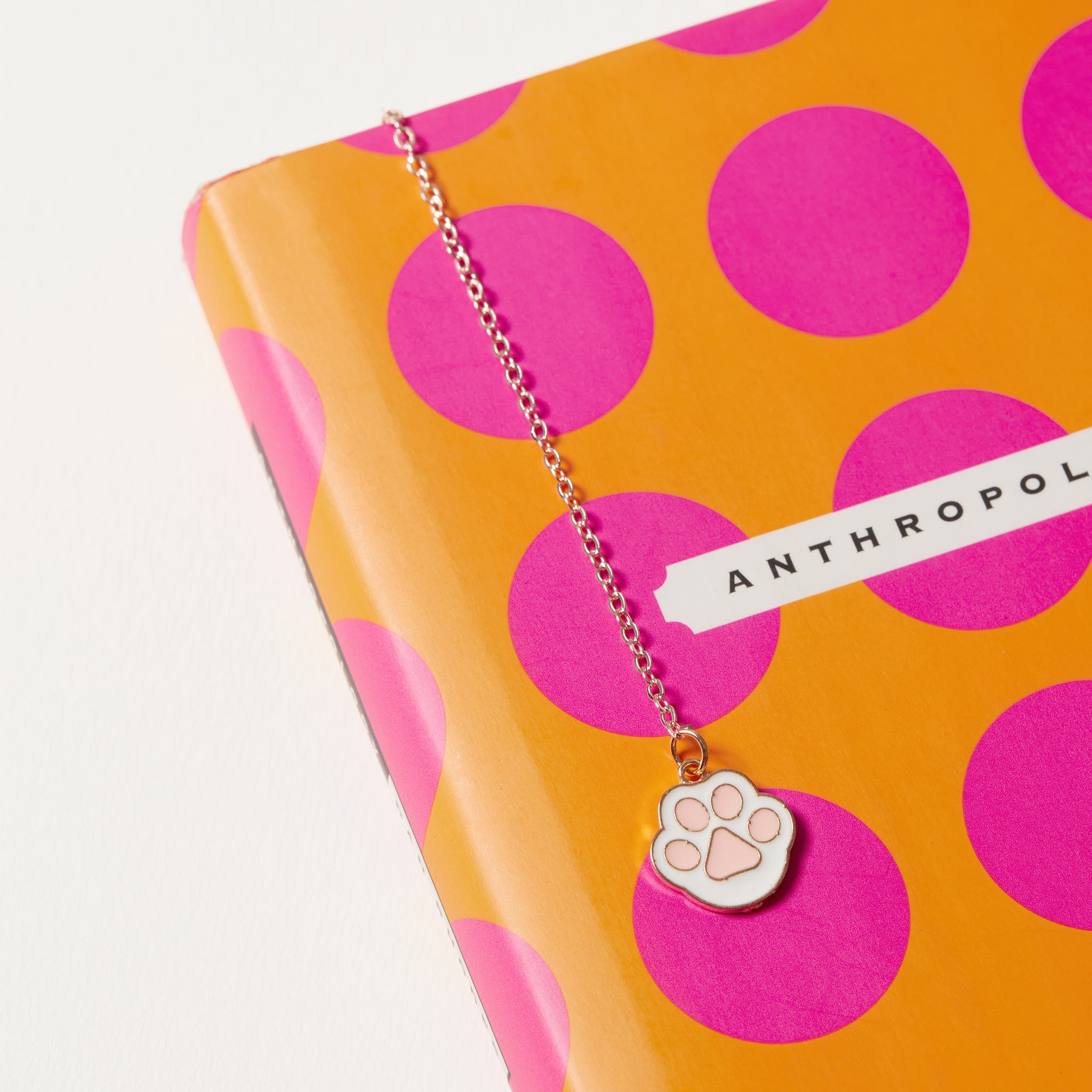 Enamel cat paw charm and book cover detail image