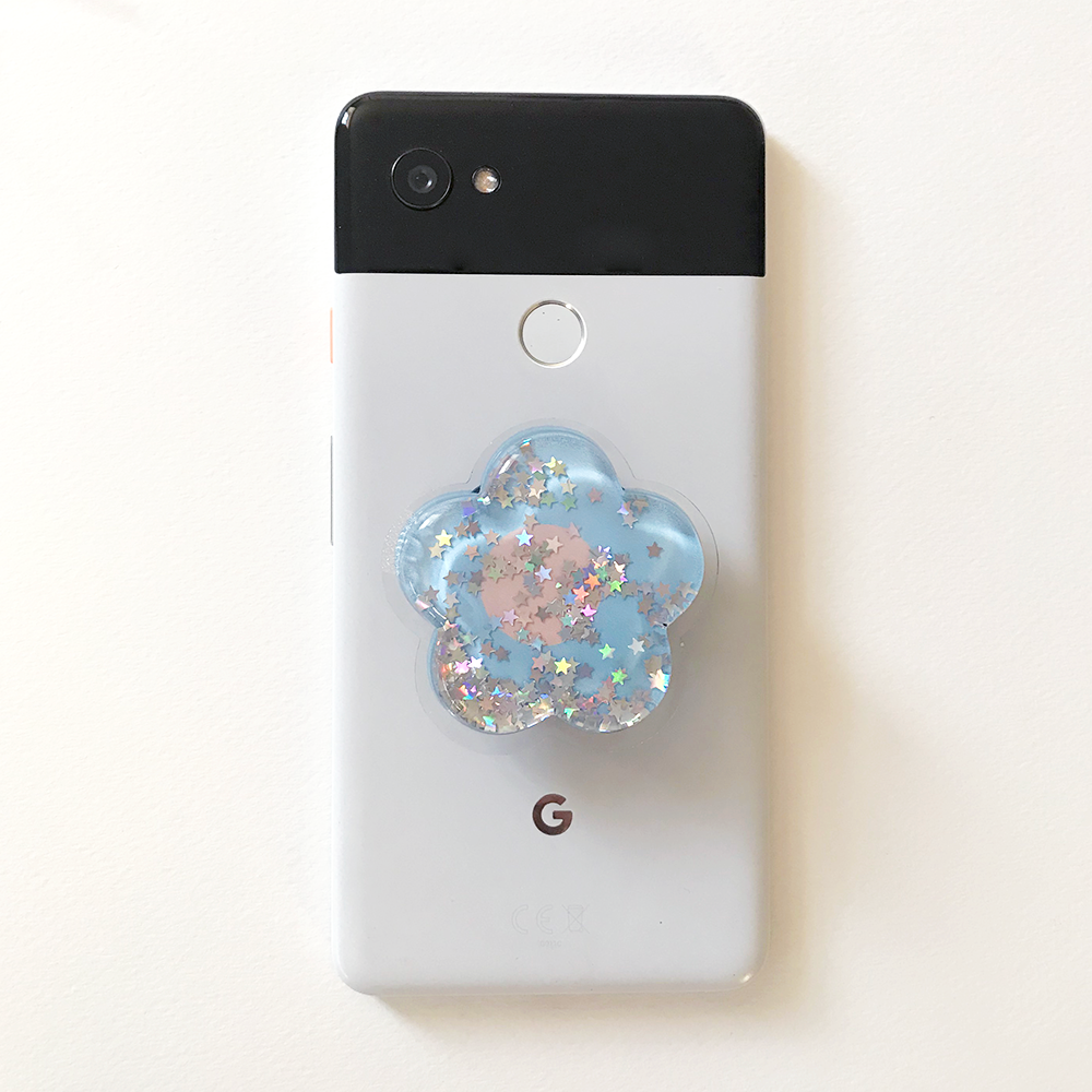 Floral glitter popsocket on Google phone