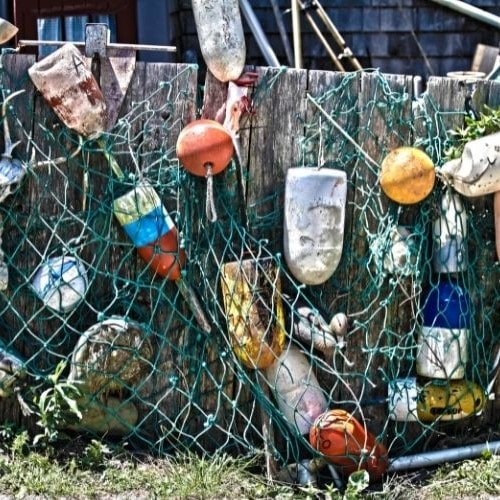 Colorful lobstertrap buoys on Nantucket fence