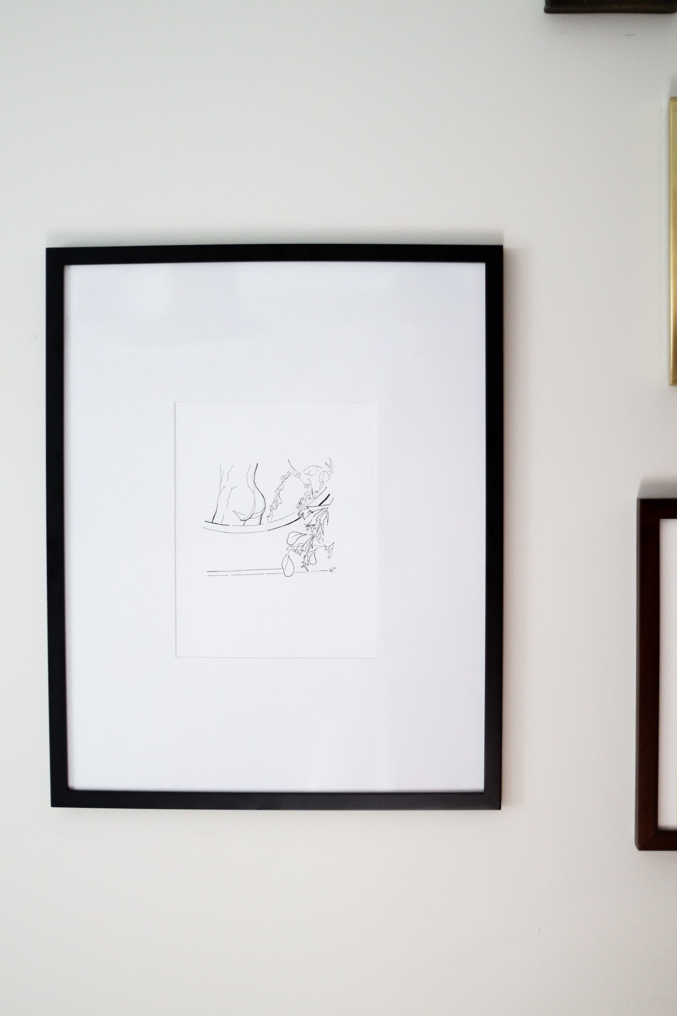Black framed 'Self' by Jonathan Kent Adams on the wall