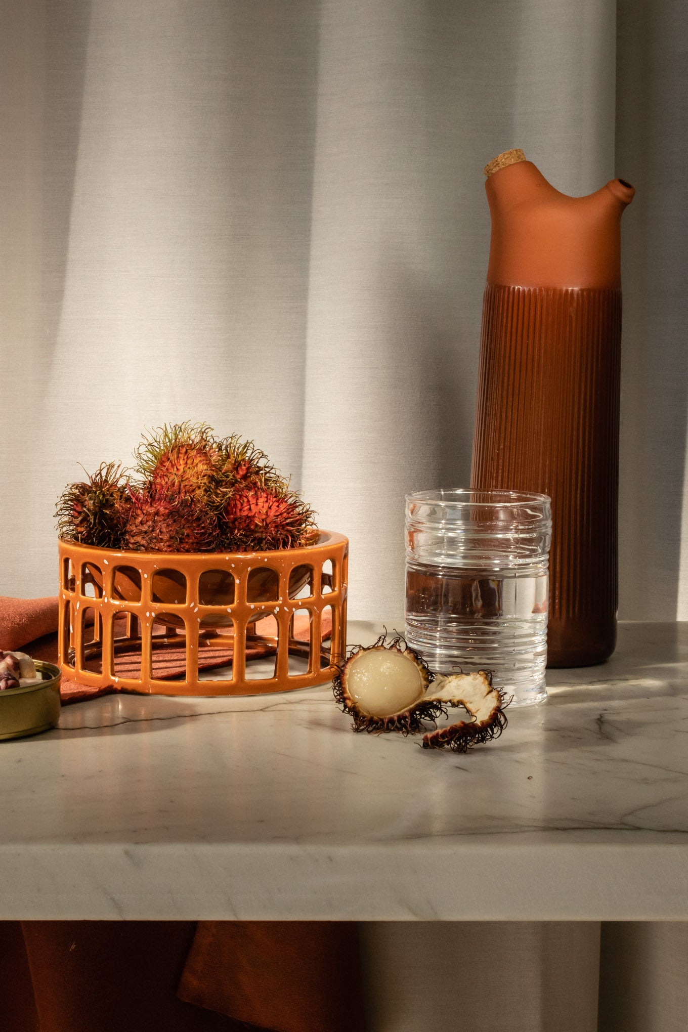 Terracotta Junto Carafe with fruits and water on the table