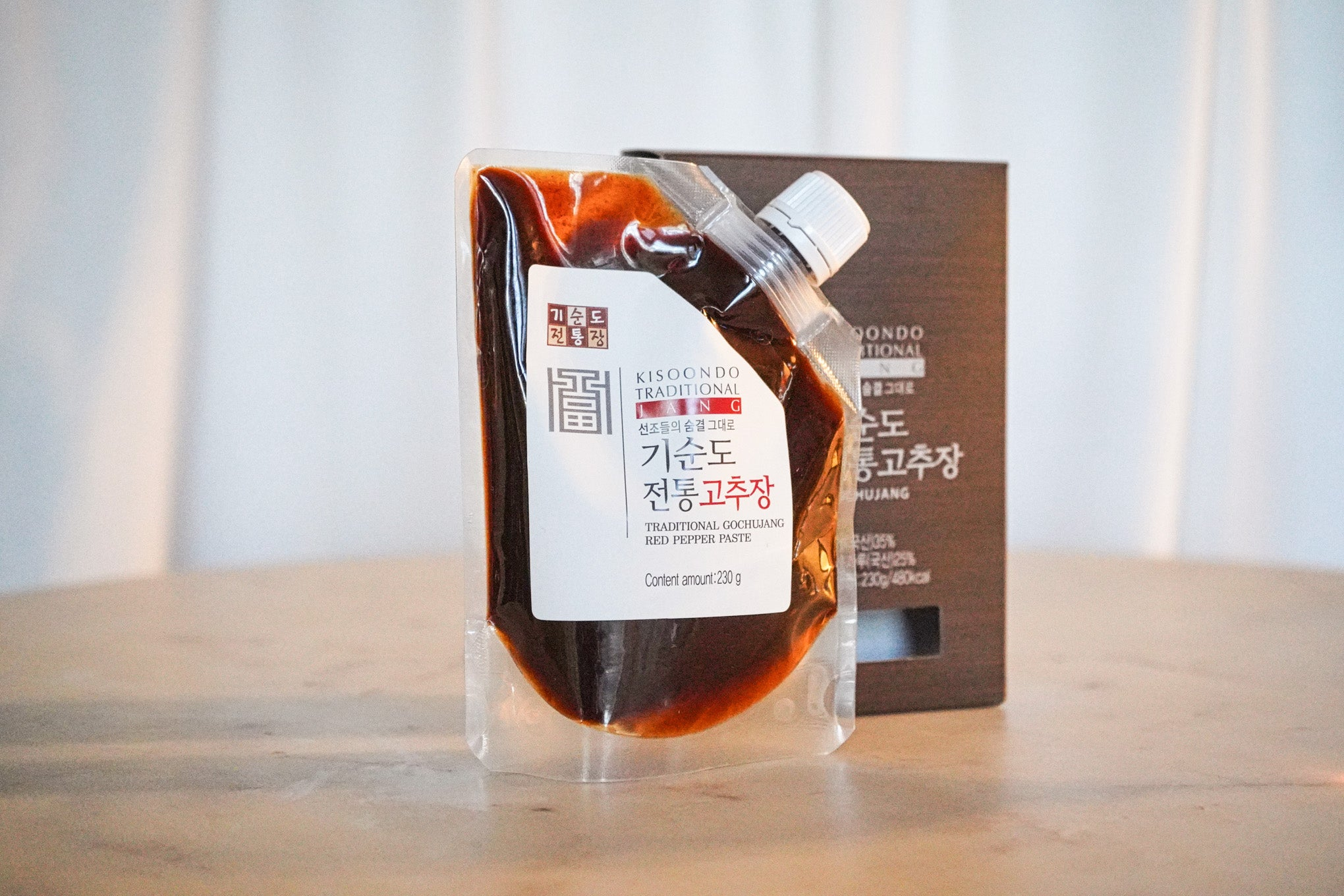 kisoondo traditional gochujang in plastic bag with brown retail box in background