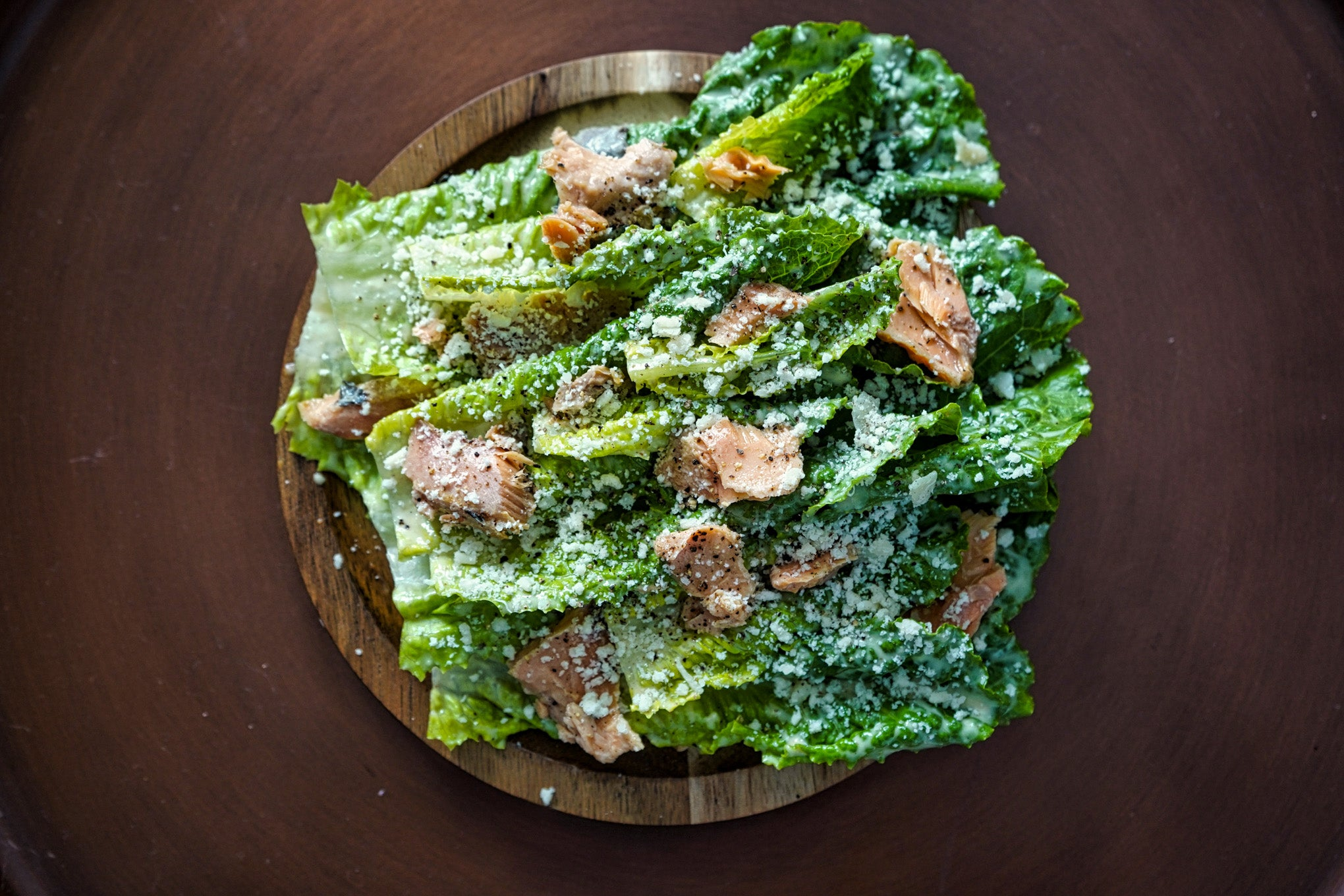 caesar salad with salmon and parmesan