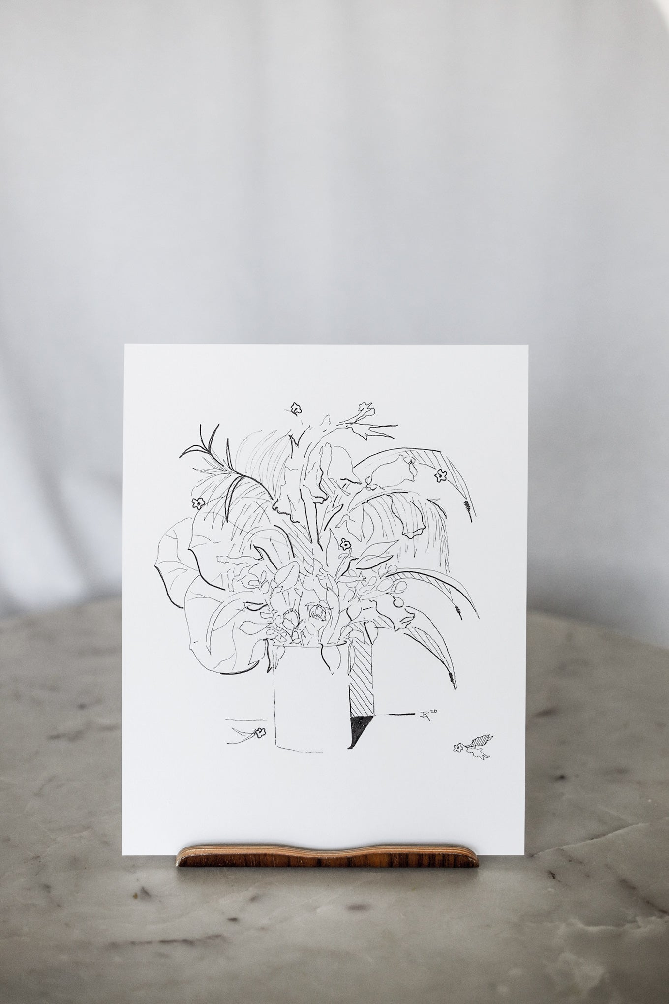 Unframed floral sketch standing on table