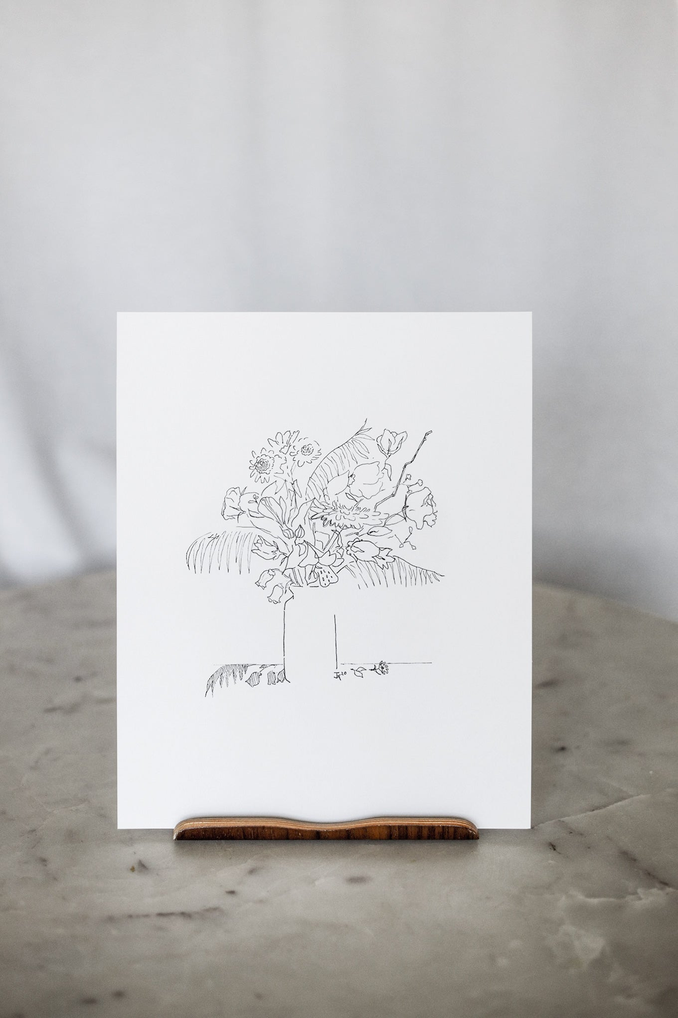 Floral sketch sitting on marble table