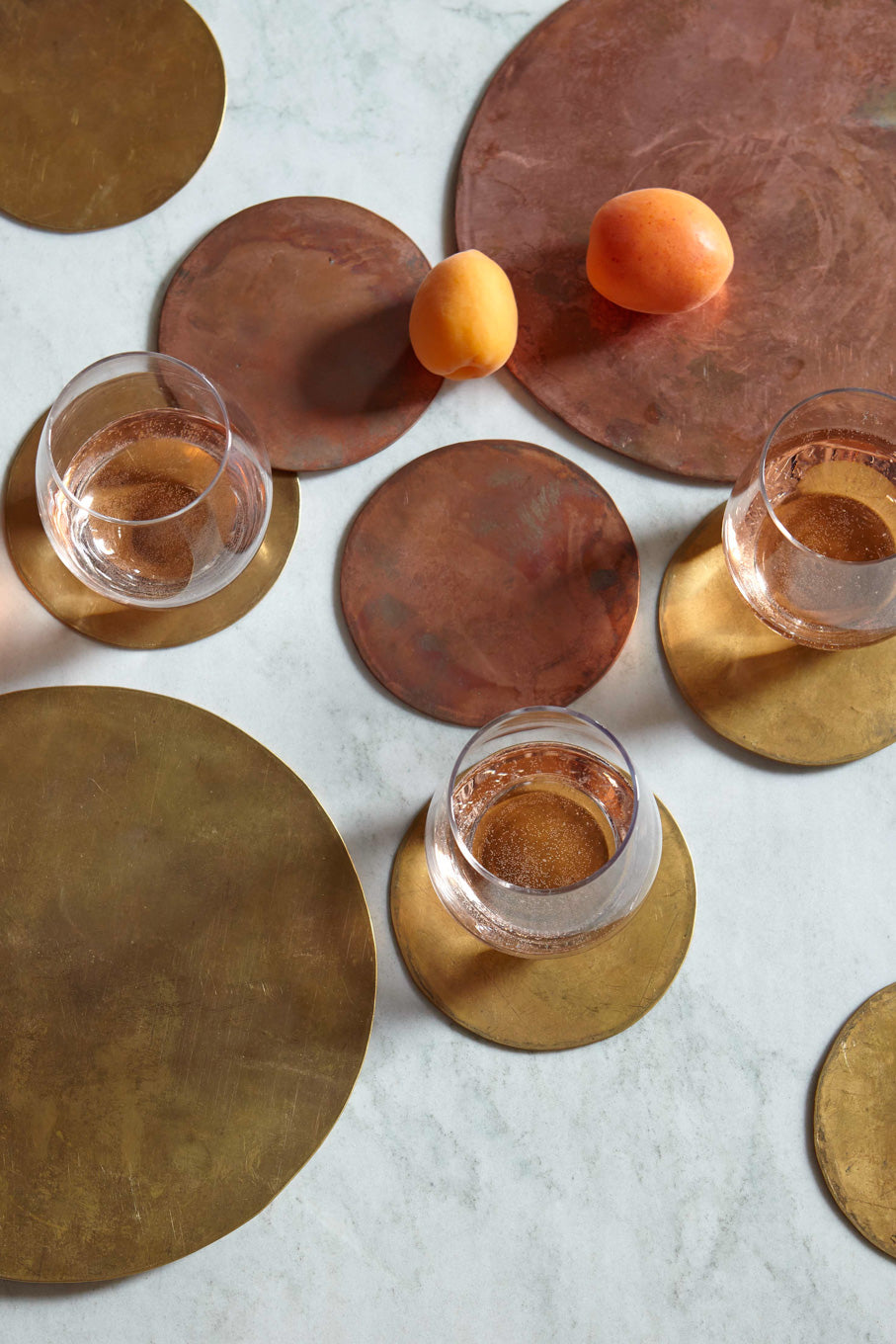 Brass trivet and brass coasters with three glasses