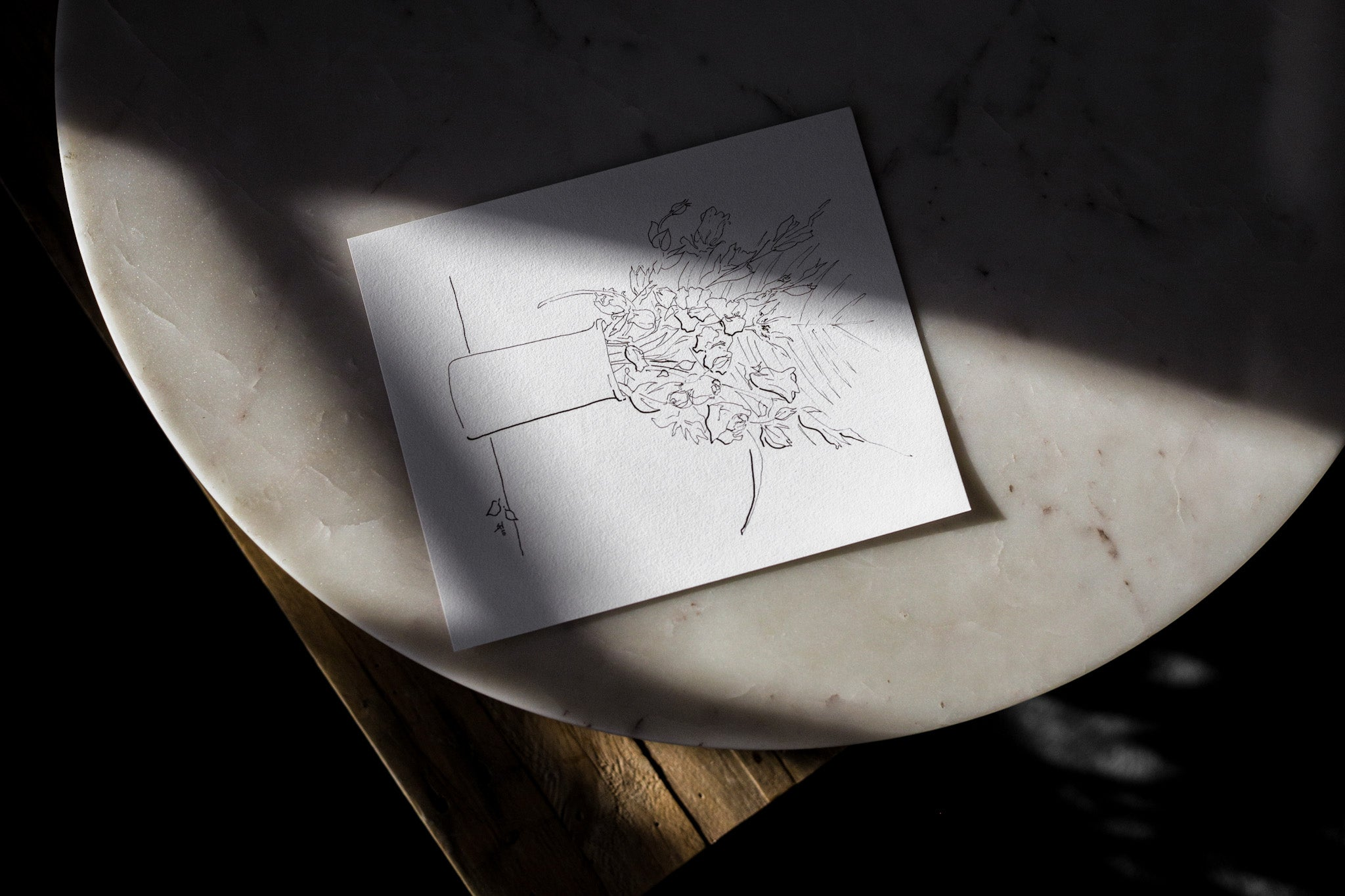 Floral sketch unframed on a marble table