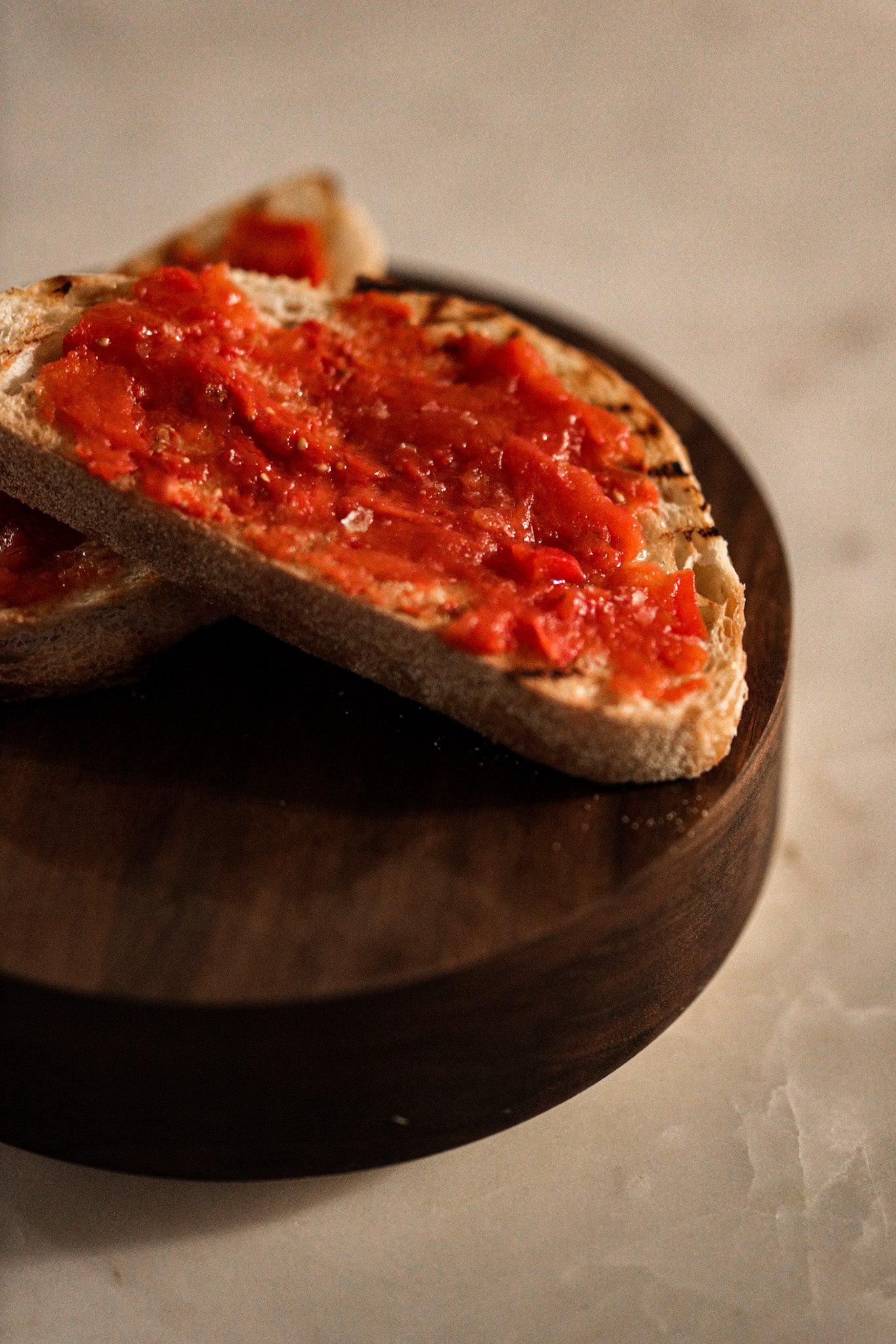 Natural Peeled Tomatoes spread on toasted bread