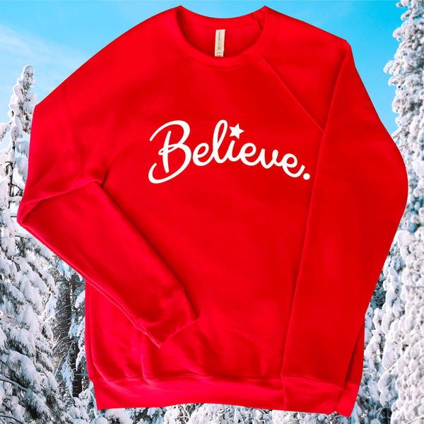 BELIEVE IN KINDNESS, BELIEVE IN THE MAGIC TIME OF THE HOLIDAY SEASON OF GIVING LOVE, JOY, HOPE TO FAMILY AND FRIENDS RED FLEECE FESTIVE SWEATSHIRT.