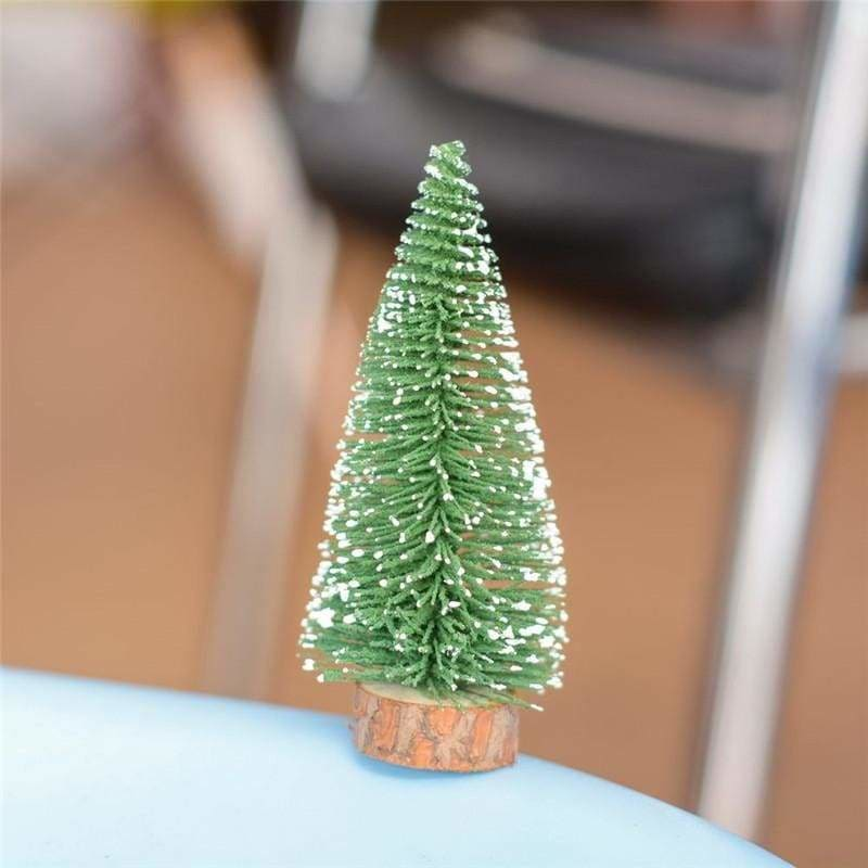 A small pine tree placed in the desktop - christmas