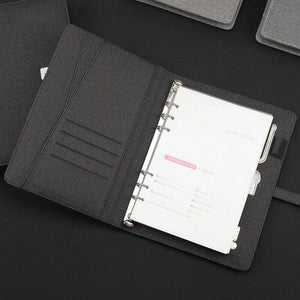 Wireless phone charging notebook - business