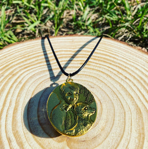 Yellow pressed flower gold pendant