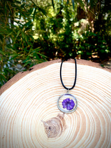 Purple pressed flower resin pendant