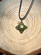 Load image into Gallery viewer, Gold pendant with pressed flower in resin