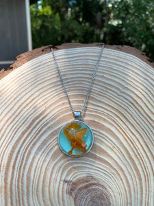 Silver and turquoise pendant with pressed orange flower