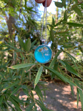 Load image into Gallery viewer, Circular turquoise pressed flower pendant