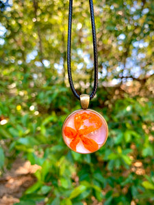Pink pendant with orange pressed flower