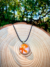 Load image into Gallery viewer, Pink pendant with orange pressed flower
