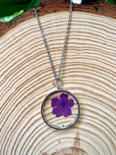 Load image into Gallery viewer, Circular silver pendant with purple pressed flower