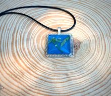 Load image into Gallery viewer, Turquoise and silver pressed flower pendant