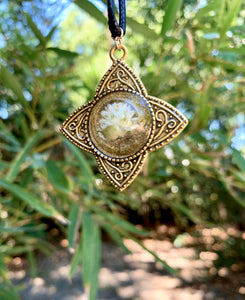 Gold pendant with pressed flower in resin