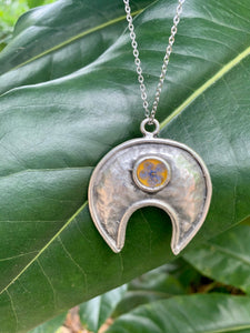 Hammered silver and yellow pendant with baby blue pressed flower