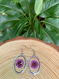 Oval silver dangle earrings with purple pressed flowers