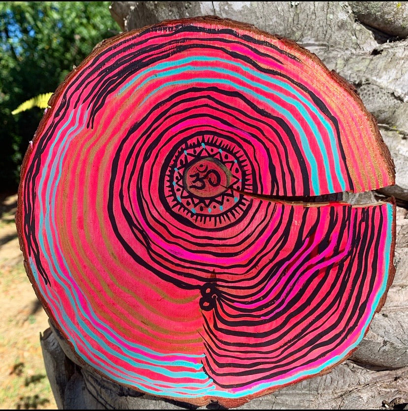 Natural wood slice wall hanging with acrylic paint