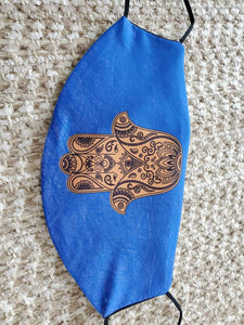 Hamsa face Cover , on Israeli blue background, metallic gold printed design, pocket filter face mask, adjustable ear straps with clips