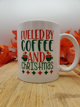 Load image into Gallery viewer, Fueled By Coffee and Christmas Mug, Holiday Gift, Seasonal Mug, Personalized Cup, Custom Coffee Mug, Add Your Name
