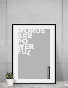 Grey Powerful Words Poster displayed in home