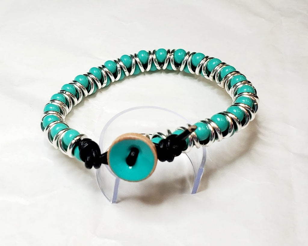 Intense Turquoise colored Size 1 Seed Bead with Leather, Silver tone Jump Rings & Ceramic Button Clasp.