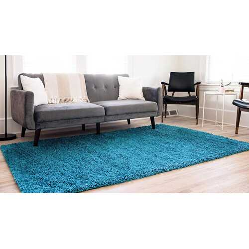 Solid Shag Collection Modern Plush Turquoise Shag Area Rug 5 ft. by 7 ft.
