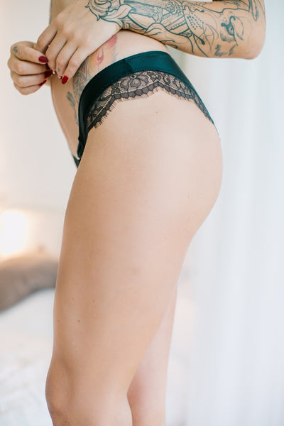 Pretty and soft satin feel briefs decorated with gorgeous eyelash lace. The front has a lovely bow detail with diamante trim. day or sleepwear