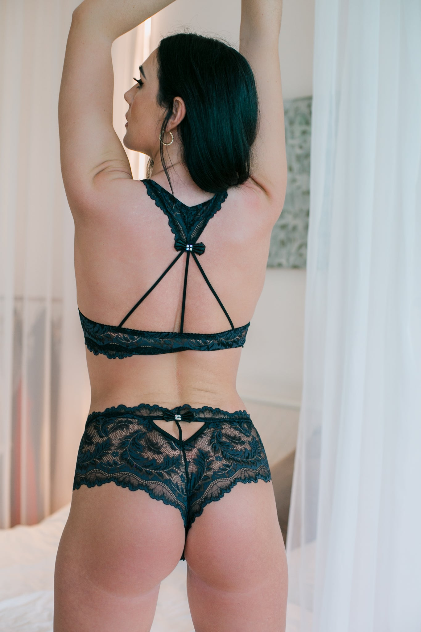 A pretty black lace brief. The back has lovey cut out design with satin ribbon bow and diamante detail. Matching Push up bra, soft cup bra & thong are available in Black, red and white. Each sold separately to maximise the mix and match options.
