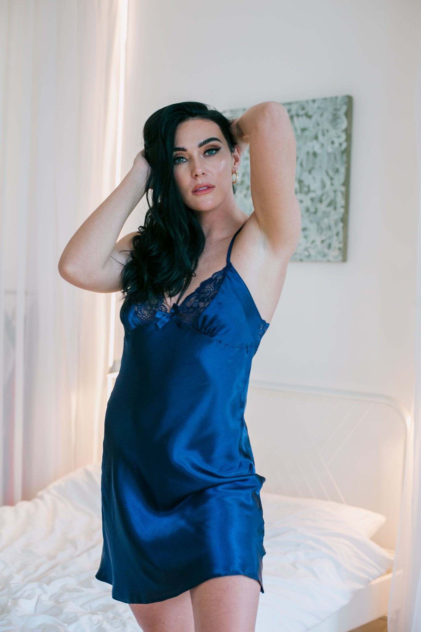 Navy Blue elegant nightdress made of the highest quality delicate satin. Beautifully decorated stretch lace cups. The back of the nightdress is also finished with stretch lace. The straps are adjustable which are crossed at the back. Knee-length at a height of 164 cm