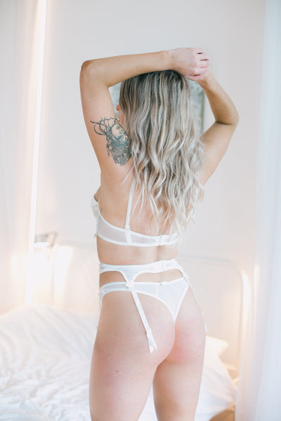 Rokoko II White Thong with beautiful sheer material intricately decorated with embordered detailing.   Matching bra and suspender belt sold separately