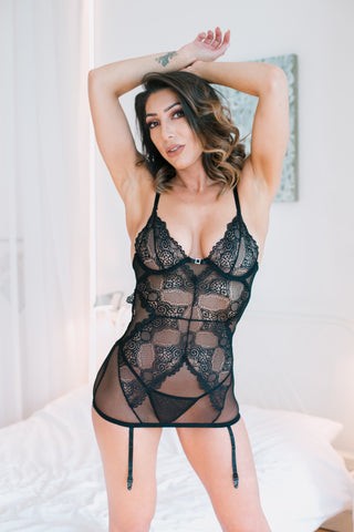 A sensual chemise / teddy / body made in beautiful lace and tulle. Adjustable straps and hook and eye closure at the back. Deep cleavage edged with lace at the back. Adjustable straps and garter belts. Thong included. In Black