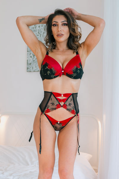 The Rufina black thong is a stunning design with red satin that features beautiful lace with floral embroidery. Decorated with a single diamante stone on a red satin bow. Also available matching Bra, Brief and Suspender belt sold separately.