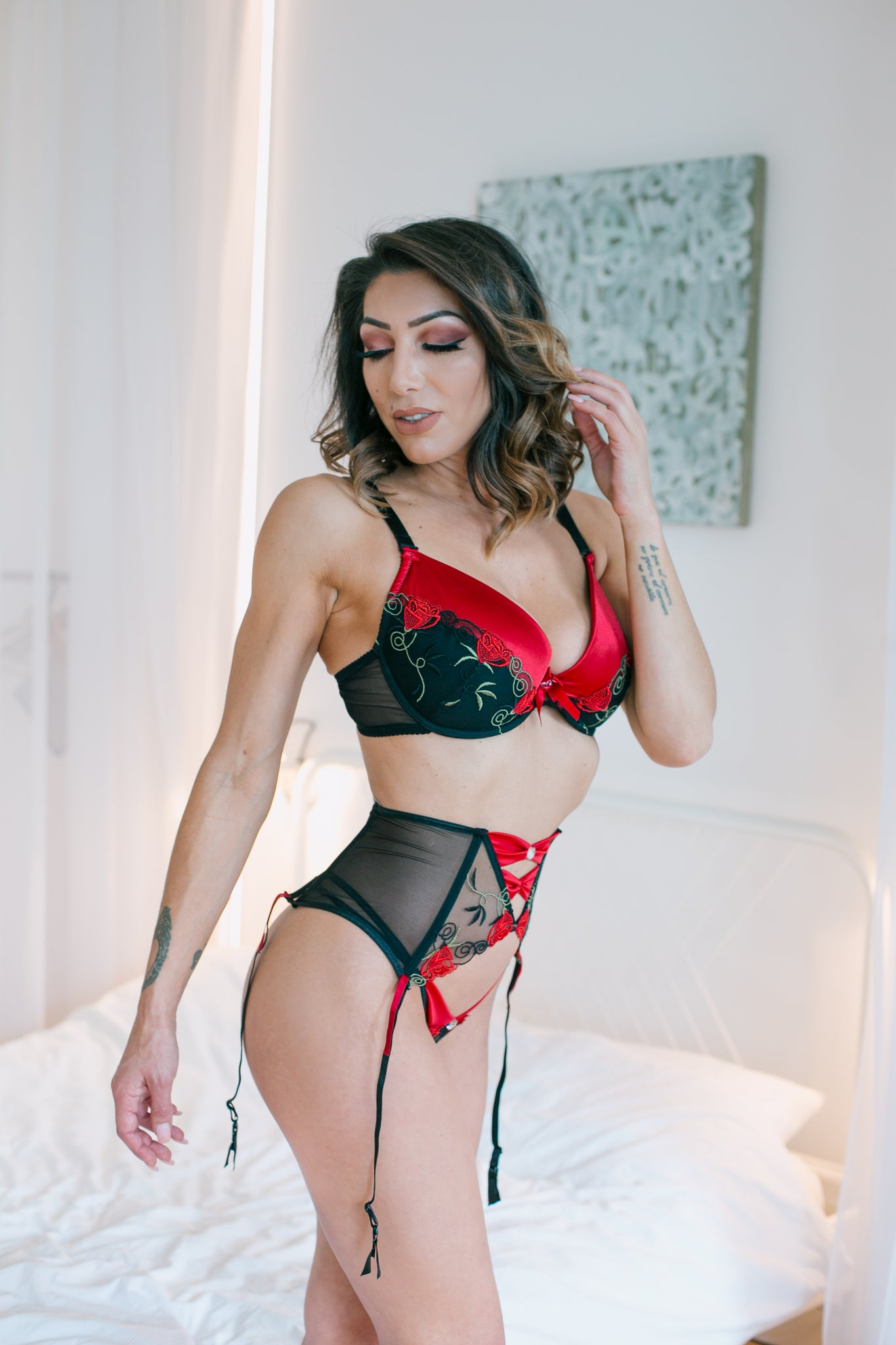 The Rufina black suspender belt is a gorgeous design with adjustable suspender straps. Beautiful red satin lace has been added to the suspender straps which contrast with the delicate lace and floral embroidery on the suspender belt. Matching bra, thong and brief sold separately.