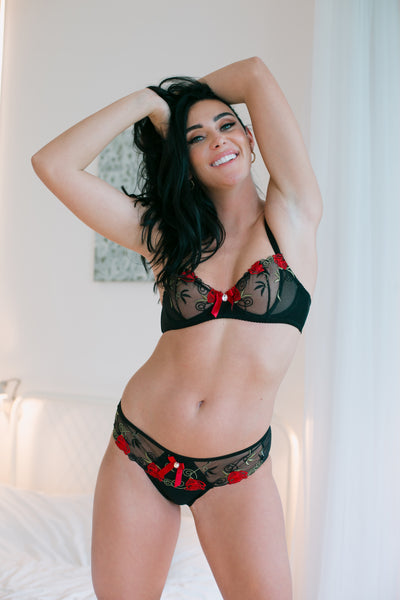 The Rufina brief is a beautiful design with black satin which features delicate lace with floral embroidery. Decorated with a single diamante stone on a red satin bow.  Bra, thong and suspender belt sold separately.