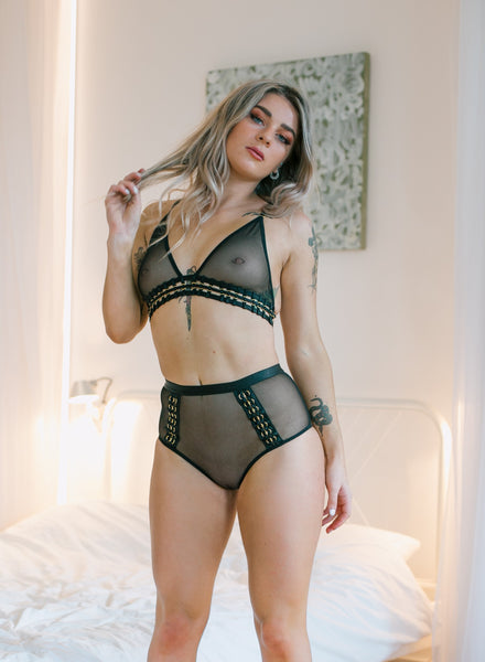 Black tempting 2 piece set . It includes a bra and high waist brief which are both decorated with see-through mesh and have a tempting braided gold ring feature. The briefs have an elasticated waistband and there is also a plain mesh on the back just like the front. The back of the bra has one adjustable hook.
